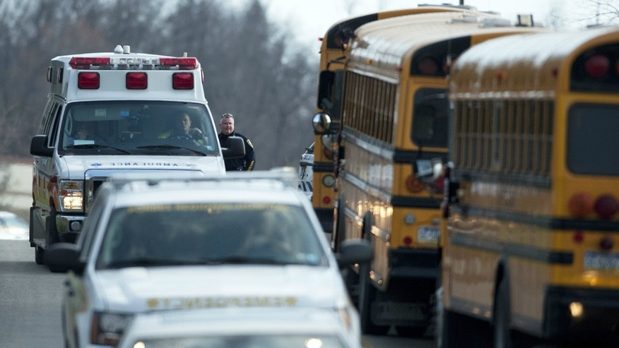 An ambulance and emergency vehicles leave Franklin Regional High School where more then a dozen students were stabbed by a knife wielding suspect on Wednesday, April 9, 2014, in Murrysville, Pa., near Pittsburgh.