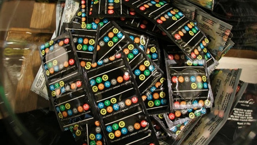 Condoms labeled like the city's subway lines to be given out for free by New York city's health department sit in a bowl inside a Kenneth Cole store, Wednesday, Feb. 14, 2007 in New York. Fashion designer Kenneth Cole joined in the campaign and designed special clothing with tiny pockets to hold the condoms. With the unveiling of the NYC Condom, New York became the first in the nation with an official brand. (AP Photo/Kathy Willens)