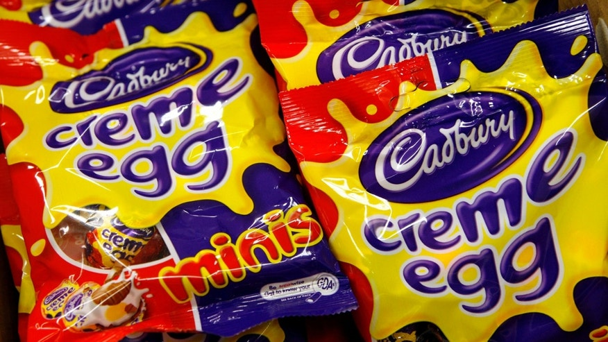 Cadbury's creme eggs minis packages are seen in a London supermarket February 10, 2007. British confectionary group Cadbury Schweppes said on Saturday it was withdrawing a number of Easter chocolate products because they did not have the correct nut allergy labelling.     REUTERS/Alessia Pierdomenico (BRITAIN) - RTR1M7UF