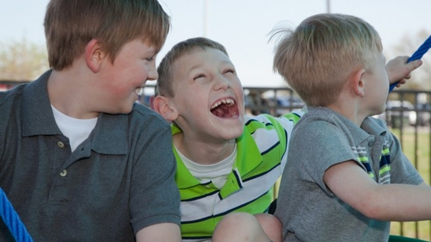 Conner, Cayden and Cooper Long enjoying the new playground. Image courtesy of Miracle Recreation.
