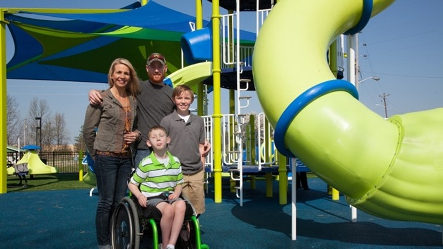 "Jenny, Jeff, Cayden and Conner Long at the ""Roll Around the Park"" playground that Conner helped design for his little brother Cayden. Image courtesy of Miracle Recreation."