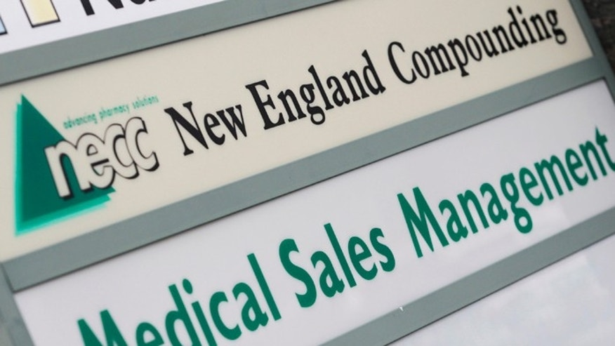 A sign for pharmaceutical compounding company New England Compounding Center (NECC).