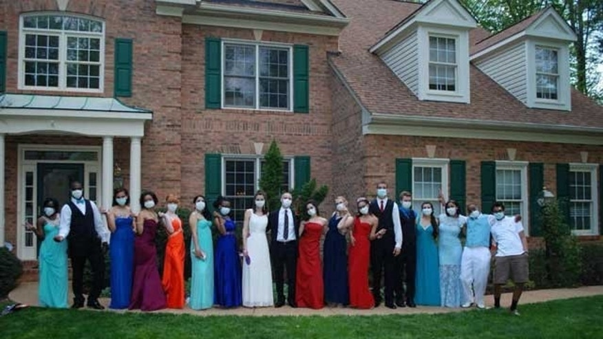 Jared Hill and his friends on prom night, wearing protective masks. (Image courtesy of My Fox Atlanta.)