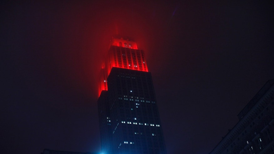 The Empire State Building is lit up in red in honor of World AIDS Day in New York December 1, 2012. (REUTERS/Eduardo Munoz)