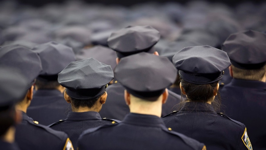 New York Police Department graduates attend their induction ceremony at Madison Square Garden in New York, December 27, 2013. (REUTERS/Carlo Allegri)