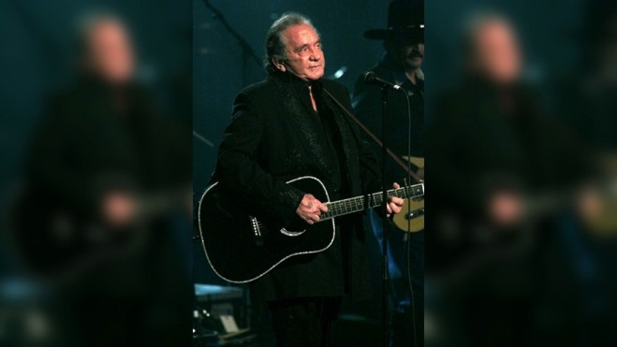 Legendary singer Johnny Cash performing in 1999. (Reuters/Jeff Christensen)