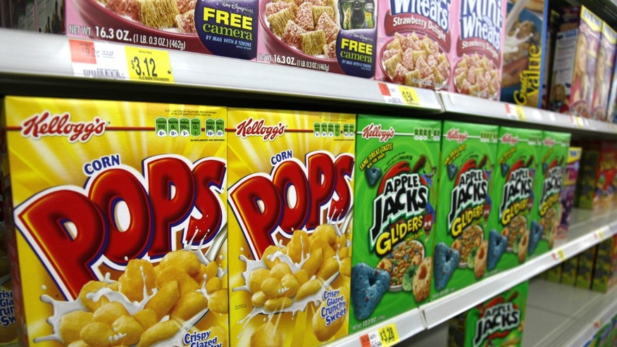 Boxes of Kellogg's cereal are displayed on a store shelf.