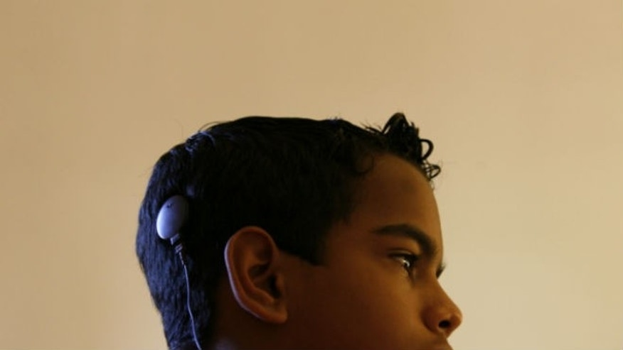 A child with a cochlear implant. REUTERS/Claudia Daut