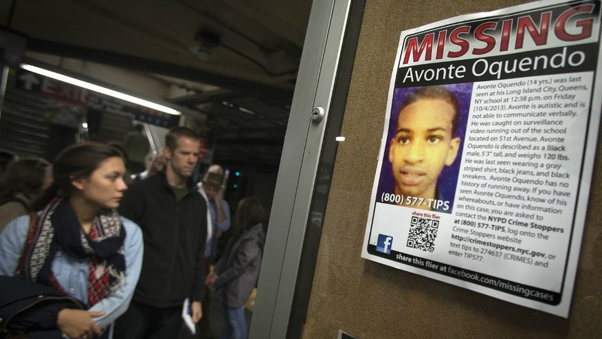 A poster for Avonte Oquendo, the 14-year-old autistic child who went missing from his school in Queens on October 4, 2013, is seen in the Times Square subway stop in New York.