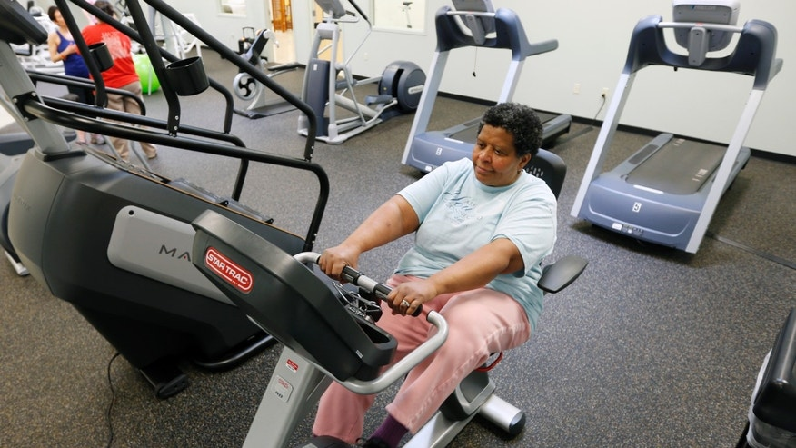 Carolyn Law of Albany works out at the Healthy Living Center located in a Hannaford supermarket in Albany, N.Y. (AP Photo/Mike Groll)