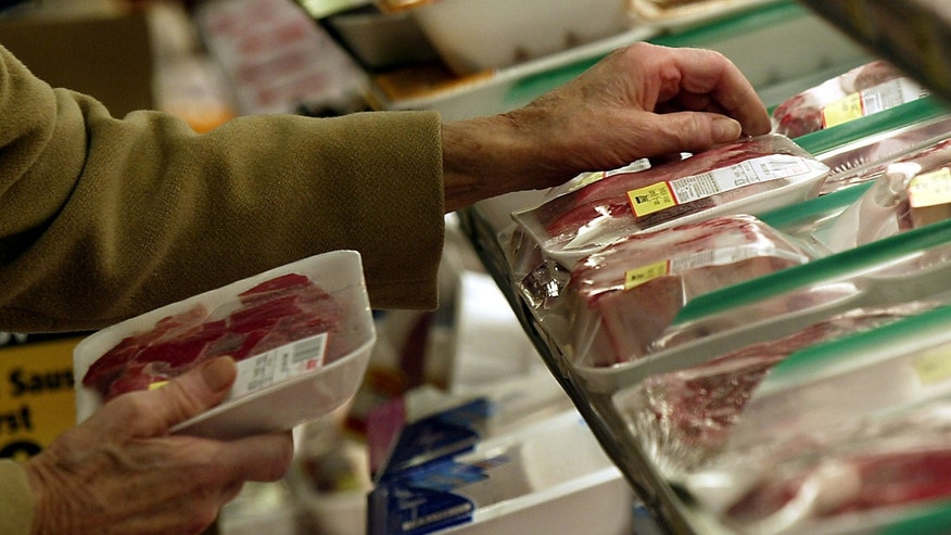 An unidentified shopper looks over the selection of steaks at local grocery store in Chicago. (Reuters)