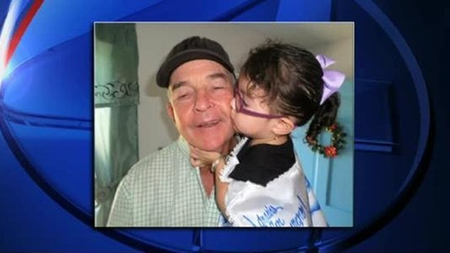 Pamela Soto, 2, and her guardian angel Danny Watson.