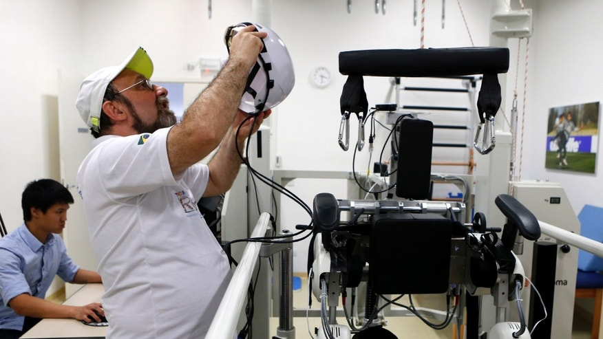 Brazilian neuroscientist Miguel Nicolelis works in his robotic laboratory in Sao Paulo May 21, 2014. (REUTERS/Paulo Whitaker)