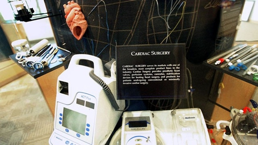 FILE - In this Aug. 16, 2005 file photo, products made for cardiac surgery are displayed at Fridley, Minn. -based Medtronic. (AP Photo/Jim Mone)