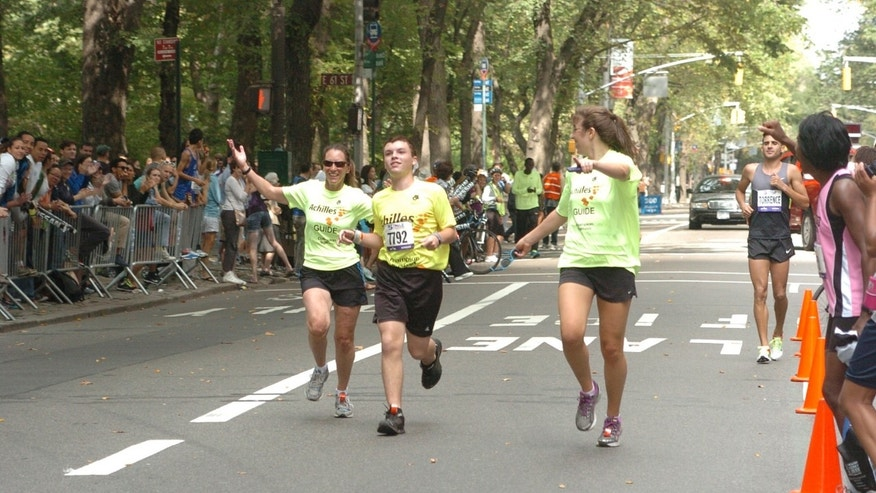 Dusty, his mother Katie, and Paula Sen finishing the 5th Avenue Mile in September 2012 in New York City.