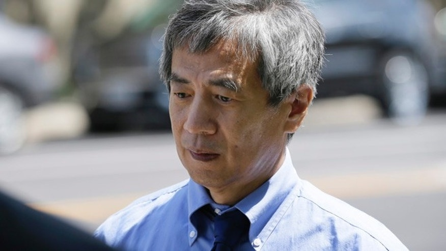 July 1, 2014: Former Iowa State University researcher Dong-Pyou Han leaves the Federal Courthouse.