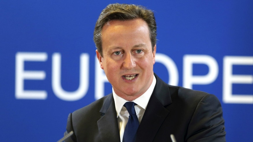 Britain's Prime Minister David Cameron holds a news conference during an European Union leaders summit in Brussels.