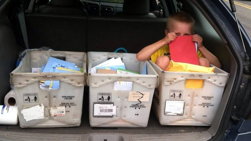 July 19, 2014: This photo shows Daniel Nickerson with bins full of mail sent to him by people across the country.