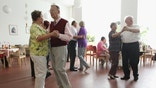 BERLIN, GERMANY - AUGUST 30:  Elderly people dance during an afternoon get-together in the community room of the Sewanstrasse senior care home in Lichtenberg district on August 30, 2011 in Berlin, Germany. The center opens its doors to non-residents every Tuesday, and between 30 and 70 retired people who still live in their own homes in the local neighborhood come to dance and chat over coffee and cake. Today's afternoon dance is part of Senior Citizens' Week (Berliner Seniorenwoche), a city initiative meant to highlight activities available for the city's eldery. Germany is facing significant demographic change that includes elderly citizens making up an increasing portion of the overall population, a situation aggravated by the country's birth rate, which is the lowest in Europe. The shift will continue to put greater strain on the country's ability to finance its public health and senior care programs.  (Photo by Sean Gallup/Getty Images)