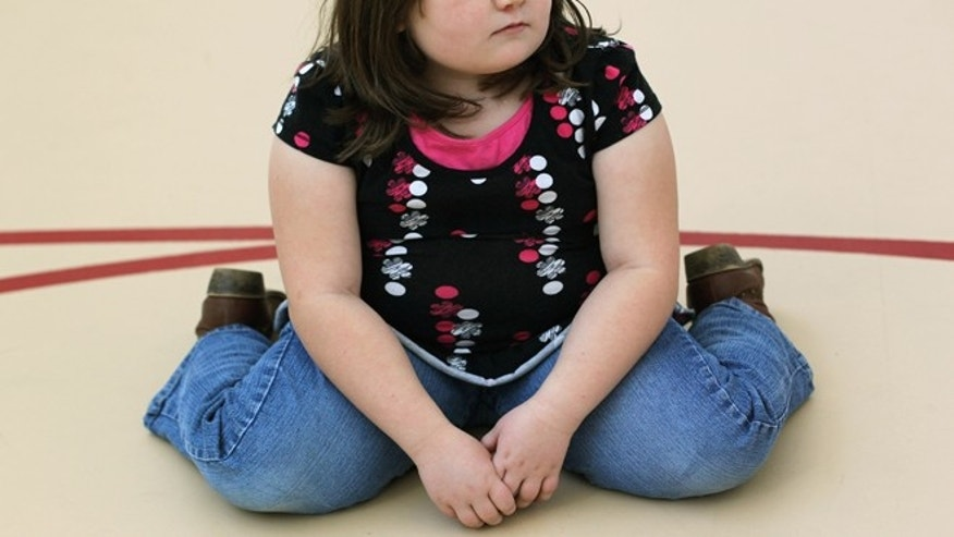 A child sits on the gym floor during a program for overweight adolescents and children on November 13, 2010 in Aurora, Colorado. Nationally, some 15 percent of children are overweight or obese, as are some 60 percent of adults.