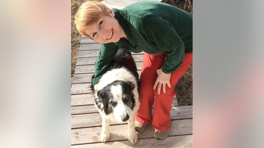 Christine Harris, professor of psychology at UC San Diego, with Samwise, one of three border collies to inspire the study on dog jealousy.