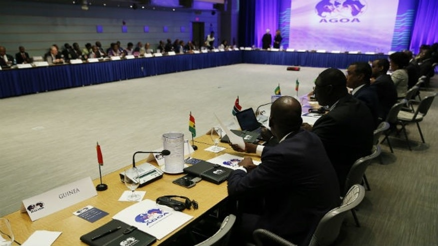 The seat of the representative from Guinea remains empty during the opening session at the AGOA Forum at the U.S.-Africa Leaders Summit in Washington August 4, 2014. The leaders of Guinea and Sierra Leone have skipped the summit to deal with the Ebola crisis in their countries. REUTERS/Gary Cameron