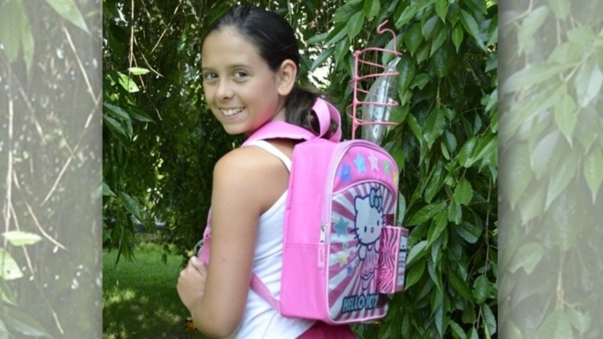 "Kylie Simonds, 11, of Naugatuck, Conn., shows off her ""chemo backpack"" for WTNH News 8 reporters."