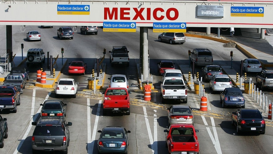 TIJUANA, MEXICO - JUNE 27:  Traffic in the US enters Mexico at the San Ysidro border crossing, the world's busiest, on June 27, 2008 in Tijuana, Mexico. With the cost of gasoline in California around $4.60 per gallon, many drivers are buying their fuel in Mexico for about $3.20. There is a price to pay for cheaper gas though. Mexican gas is formulated with more sulfur than California gas and that can damage the emission control equipment on US cars, causing them to fail emissions tests and leading to expensive repairs. In addition, unless a driver has other business in Mexico, part of their fuel savings will be burned up idling in a line that can easily last for hours to get back into the US.   (Photo by David McNew/Getty Images)