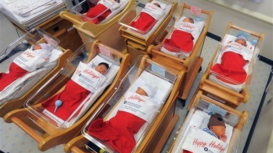 Newborns sleep in oversized red stockings in the nursery at Long Beach Memorial in Long Beach, Calif., on Monday, Dec. 23, 2013.