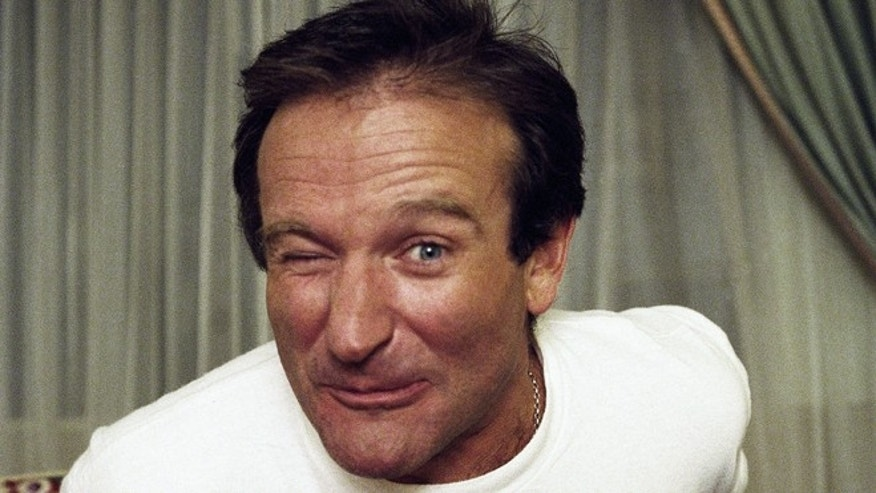 Comedian Robin Williams makes a face as he rises out of his chair during an interview, Nov. 15, 1993, New York.  (AP Photo/Wyatt Counts)