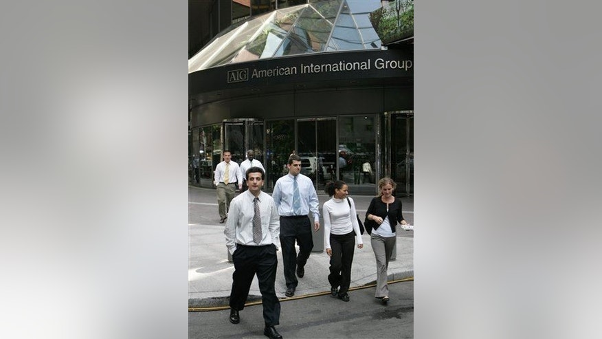 People walk in front of AIG offices Wednesday, Sept. 17, 2008 in New York.