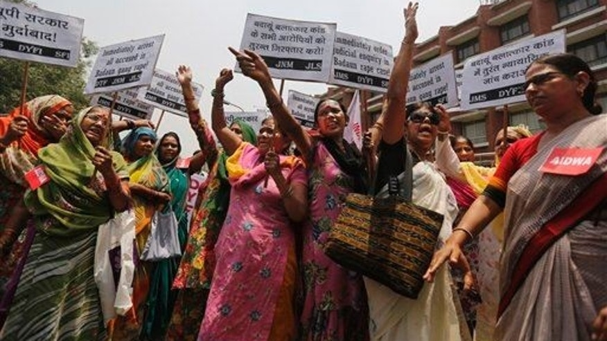 In this file photo, members of the All India Democratic Women's Association protest the gang rape of two teenage girls in May. The girls were attacked going to the bathroom in fields.