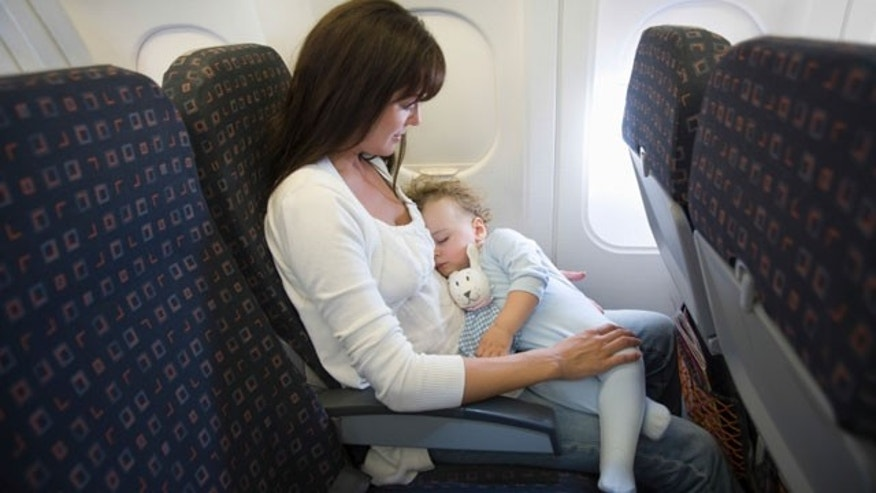 Baby Sleeping On Mother's Laps In Airplane
