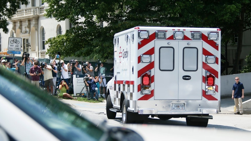 An ambulance transporting Nancy Writebol, an American missionary stricken with Ebola, arrives at Emory University Hospital, Tuesday, Aug. 5, 2014, in Atlanta. (AP Photo/Jason Getz)
