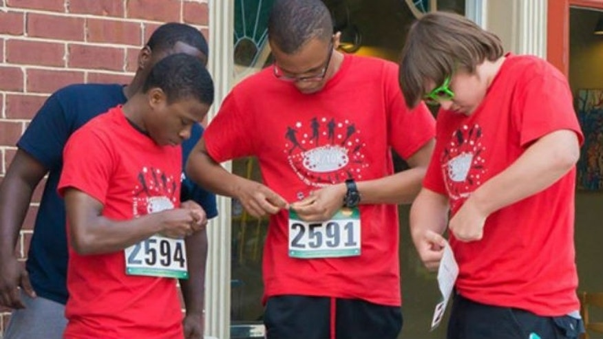 Young runners attach their bibs before this year's Ferguson Twilight Run.