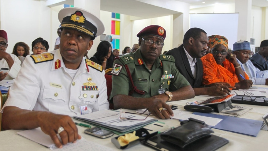 Nigerian navy and military medical directors attend the second general meeting with Nigeria's Health Minister Onyebuchi Chukwu (not pictured) during a media briefing on updates regarding the ongoing national Ebola disease outbreak, in Abuja September 1, 2014. REUTERS/Afolabi Sotunde