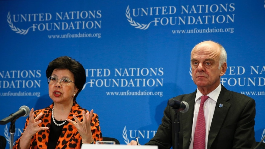 World Health Organization (WHO) Director-General Dr. Margaret Chan (L) and Senior United Nations System Coordinator for Ebola Virus Disease Dr. David Nabarro appear at a briefing to discuss the Ebola outbreak in West Africa at the UN Foundation in Washington September 3, 2014.     REUTERS/Gary Cameron