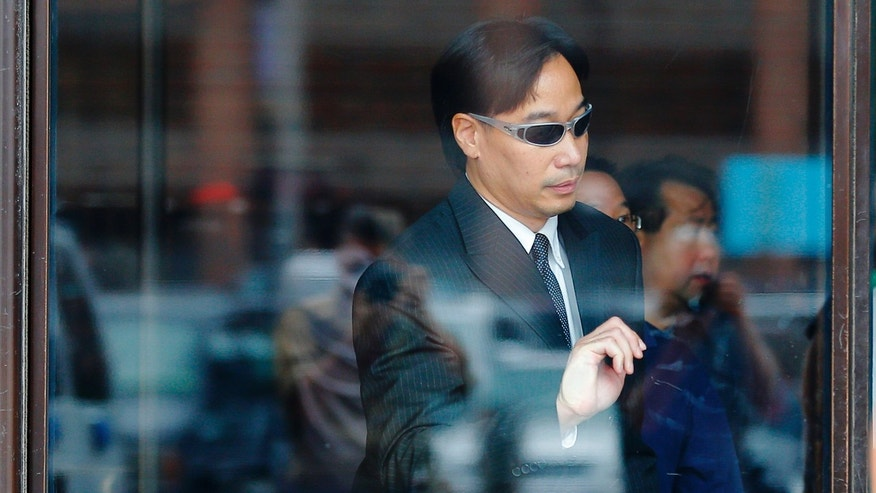 Glenn Adam Chin leaves the federal courthouse in Boston, Massachusetts September 11, 2014 following his arraignment on a mail fraud charge. REUTERS/Brian Snyder