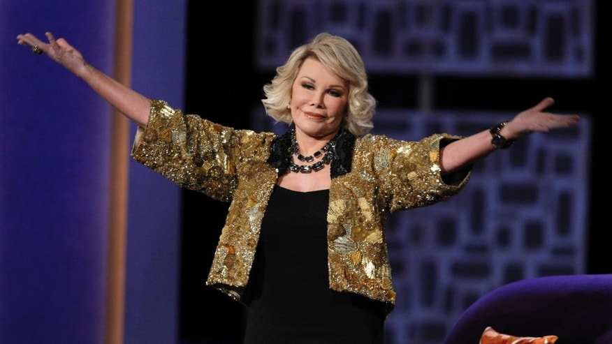 "July 26, 2009. Joan Rivers greets the audience at the ""Comedy Central Roast of Joan Rivers"" in Los Angeles."