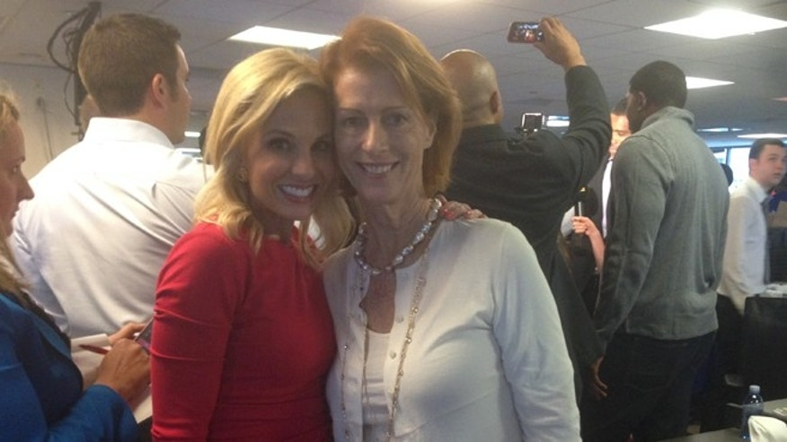 """Fox & Friends"" co-host, Elisabeth Hasselbeck, poses with Noreen Fraser on BCG Partners (Cantor Fitzgerald) Charity Day on September 11, 2014."