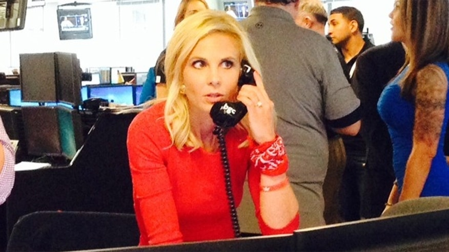"""Fox & Friends"" co-host, Elisabeth Hasselbeck closes a stock exchange transaction with a client behalf of the Noreen Fraser Foundation at BCG Partners (Cantor Fitzgerald) Charity Day on September 11, 2014 in New York City."