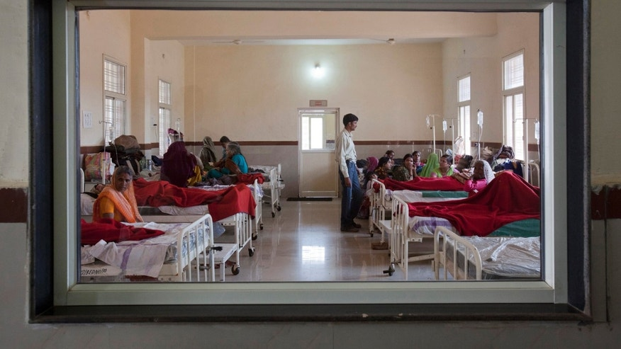 Women who have recently given birth and their relatives are pictured through a nurse';s observaton window as they rest in a post delivery ward at a district hospital in Shivpuri, in the central Indian state of Madhya Pradesh, February 25, 2012. REUTERS/Vivek Prakash
