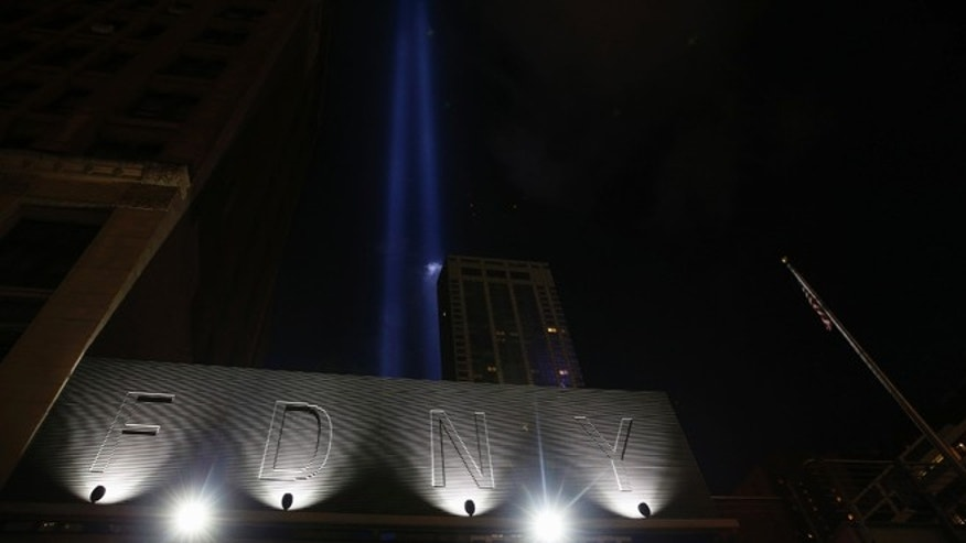 The Tribute in Lights illuminates the sky over FDNY Engine Company and Ladder Company 10 near the memorial site in New York September 10, 2014. Until a few months ago, the part of New York City where crowds will gather on Thursday morning to mark the 13th anniversary of the September 11 attacks on the United States had been mostly fenced off to the public. This year, for perhaps the first time since the attacks, a sense of normalcy and openness has taken root in the city blocks where two airliners hijacked by militants from al Qaeda crashed into the World Trade Center's twin towers. Rebuilding efforts at the site, where 2,753 people died, are nearing completion.  REUTERS/Shannon Stapleton