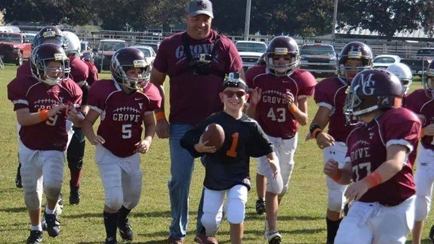 Sept. 27, 2014: Six-year-old Liam Myrick scores his first touchdown.