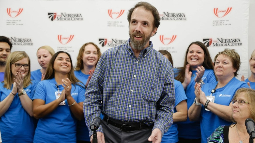 Sept. 25, 2014: Former Ebola patient Dr. Richard Sacra arrives to a news conference at the Nebraska Medical Center in Omaha, Neb.