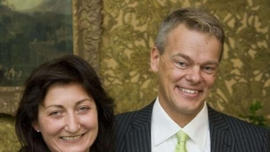 Sept. 22, 2008: Norwegian scientists May-Britt and Edvard Moser smile when they receive the Fernstrom award in Lund in this file photo.