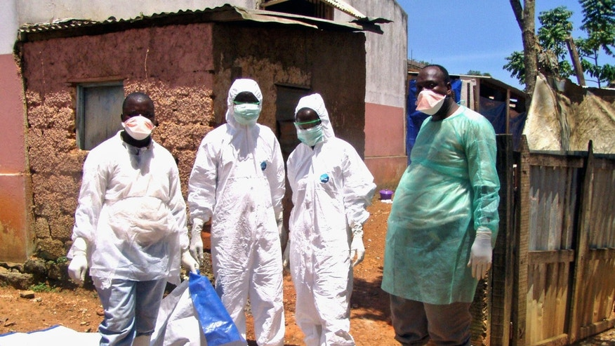 March 27, 2005: Medical workers are seen wearing protection equipment during deadly Marburg hemorrhagic fever outbreak in Uige, northern Angola.