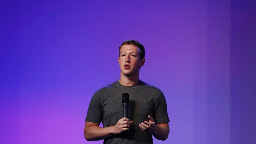 Mark Zuckerberg, founder and CEO of Facebook, addresses a gathering during the Internet.org Summit in New Delhi October 9, 2014. REUTERS/Adnan Abidi