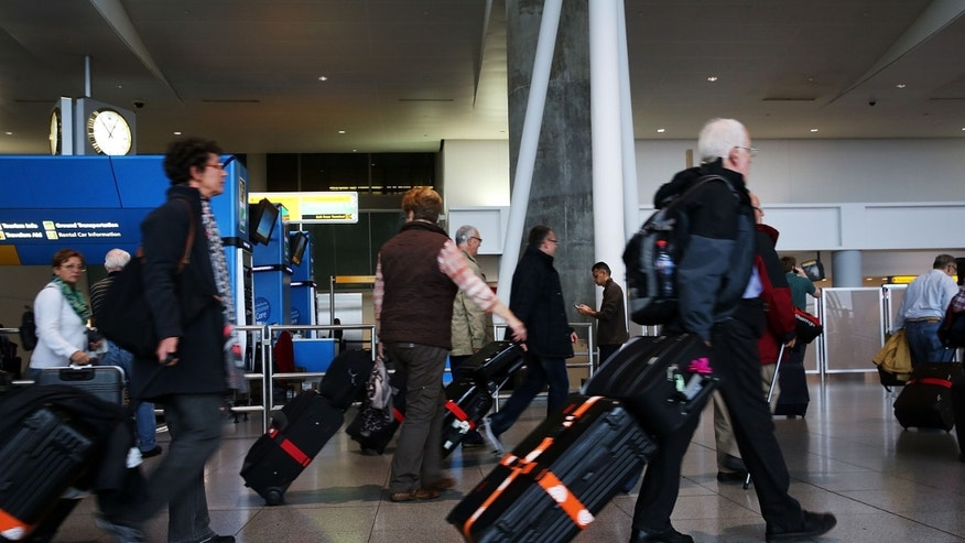 NEW YORK, NY - OCTOBER 11:  People arrive at the international arrivals terminal at New York's John F. Kennedy Airport  (JFK ) airport on October 11, 2014 in New York City.  Ebola screenings began on Saturday at JFK for travelers arriving from West African countries that have been afftected by the disease.  (Photo by Spencer Platt/Getty Images)