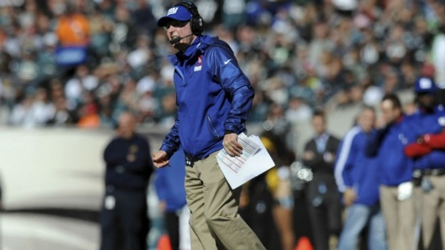 Oct 27, 2013; Philadelphia, PA, USA; New York Giants head coach Tom Coughlin looks on against the Philadelphia Eagles during the first half at Lincoln Financial Field. Mandatory Credit: Joe Camporeale-USA TODAY Sports - RTX14QOC